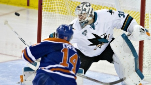 San Jose Sharks' goalie Martin Jones makes the save on Edmonton Oilers' Jordan Eberle during third period NHL action, in Edmonton, on Wednesday, Dec. 9, 2015. (Jason Franson / THE CANADIAN PRESS)