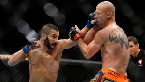 John Makdessi punches Donald Cerrone at UFC 187 on May 23, 2015, in Las Vegas. (John Locher / AP)