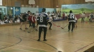 students and teachers play hockey at Pierre de Coubertin school