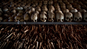 In this Friday, April 4, 2014 file photo, the skulls and bones of some of those who were slaughtered as they sought refuge inside the church are laid out as a memorial to the thousands who were killed in and around the Catholic church during the 1994 genocide in Ntarama, Rwanda. (AP Photo/Ben Curtis)