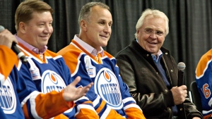 Jari Kurri, left, Paul Coffey and Glen Sather listen to teammates tell stories during the 1984 Stanley Cup Reunion Introductory Media Availability in Edmonton, Alta., on Wednesday, Oct, 8, 2014. (THE CANADIAN PRESS/Jason Franson)