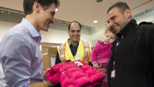 Justin Trudeau greeting Syrian refugees