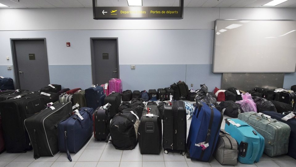 The luggage of newly-arrived Syrian refugees waits to be loaded at Pearson International airport, in Toronto, on Friday, Dec. 11, 2015. (Nathan Denette / THE CANADIAN PRESS)