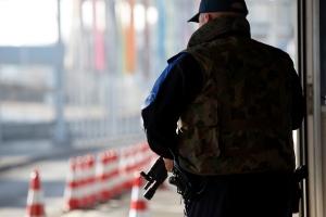 A Swiss border guard controls the area at the French-Swiss border due to a high level of alert, in Bardonnex near Geneva, Switzerland, Friday, Dec. 11, 2015. (Salvatore Di Nolfi/Keystone via AP)