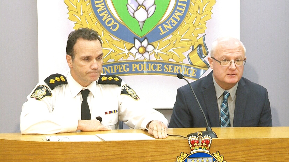 Winnipeg Police Deputy Chief Danny Smyth, left, and Winnipeg Police Sgt. John O'Donovan announce an arrest in the homicide investigation of Tina Fontaine, in Winnipeg, Friday, Dec. 11, 2015.