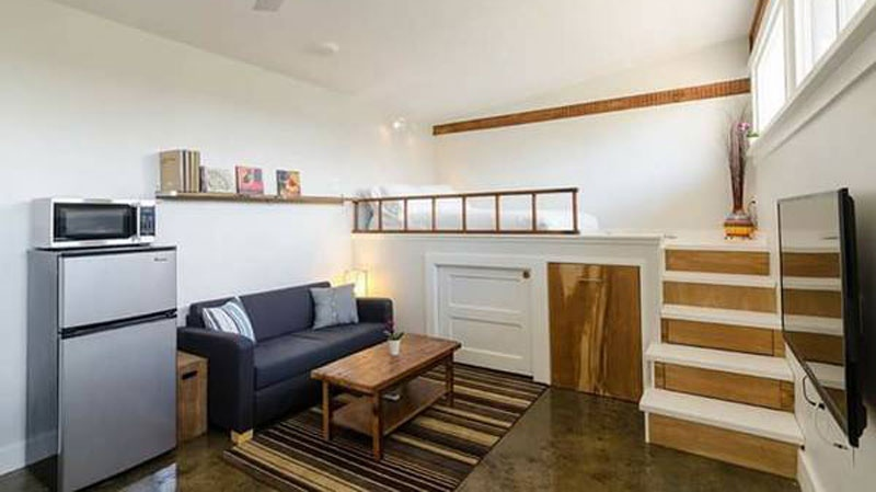 This 250-square-foot custom home, which features a full-sized kitchen and custom loft bed, must be moved off the property. (Ches Lam)