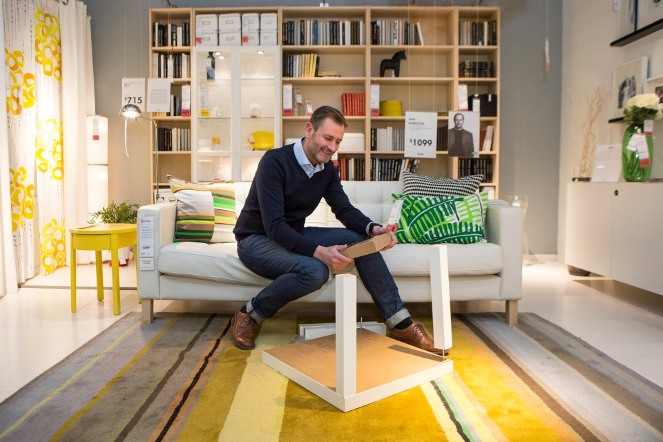 Ikea Canada president Stefan Sjostrand puts together a flat pack table in an Ikea store in Toronto on Wednesday January 28, 2015. (Chris Young/THE CANADIAN PRESS)