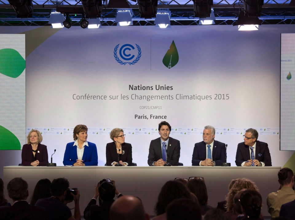 Canadian Prime Minister Justin Trudeau speaks during a news conference with Albeta Premier Rachel Notley (left), B.C. Premier Christy Clark , Ontario Premier Kathleen Wynne , Quebec Premier Philippe Couillard and Saskatchewan Premier Brad Wall at the United Nations climate change summit Monday, November 30, 2015 in Le Bourget, France. (Adrian Wyld/THE CANADIAN PRESS)