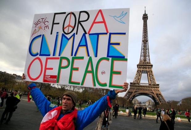 Activist near Eiffel Tower during COP21
