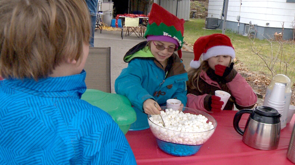 Abigail MacDonald (left) spent her seventh birthday selling hot chocolate to raise money for a family of Syrian refugees. In a single day, she raised $1,800.