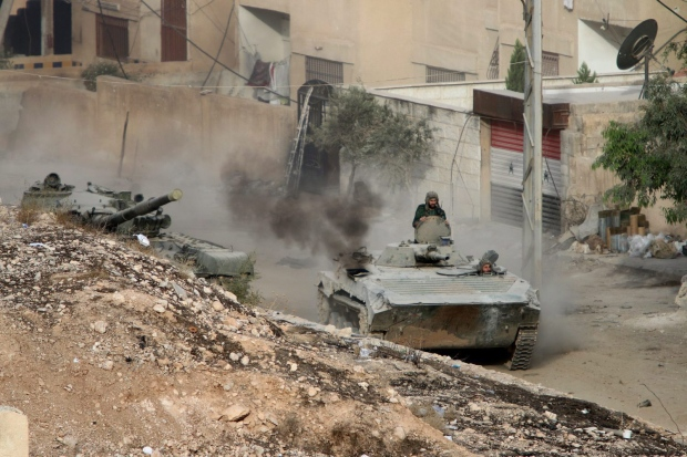 Syrian rebels fire mortar shells into damascus for Landscaping rocks windsor ontario