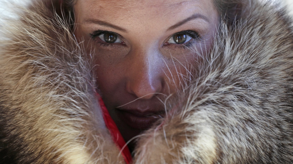 Pam Paquin poses with an 'accidental fur' raccoon neck muff she created in Central Massachusetts, Wednesday, Nov. 18, 2015. (AP / Charles Krupa)