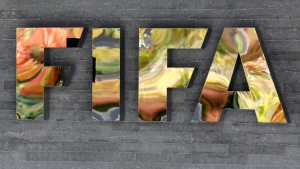 In this Sept. 25, 2015 file photo, the FIFA logo is fixed on a wall of the FIFA headquarters in Zurich, Switzerland. (AP Photo/Michael Probst, File)