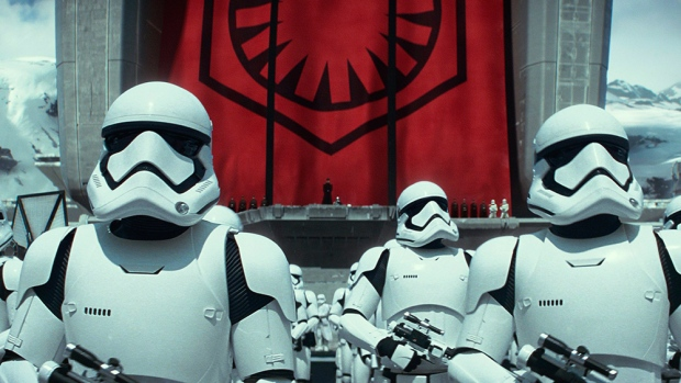 """This photo provided by Disney/Lucasfilm shows stormtroopers in a scene from the new film, """"Star Wars: The Force Awakens."""" The movie releases in the U.S. on Dec. 18, 2015. (Film Frame/Lucasfilm via AP)"""