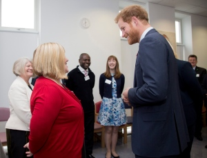 Prince Harry, right, meets Sharon Smith, Office Manager and Personal Assistant, during his visit to Mildmay hospital and charity, to mark the official opening of their new purpose-built facilities, in London, Monday Dec. 14, 2015. (Yui Mok/Pool Photo via AP)