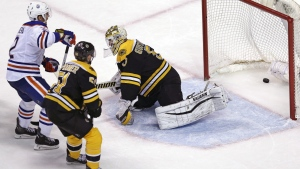Edmonton Oilers Andrej Sekera, left, beats Boston Bruins goalie Jonas Gustavsson for the game-winning goal during an overtime period of an NHL hockey game in Boston, Monday, Dec. 14, 2015. (AP / Charles Krupa)