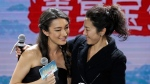 Malaysian actress Michelle Yeoh shares a light moment with Australian actress Natasha Liu Bordizzo as they arrive for a press conference for the movie 'Crouching Tiger, Hidden Dragon: Sword of Destiny' in Beijing, Tuesday, Dec. 15, 2015. (AP / Andy Wong)