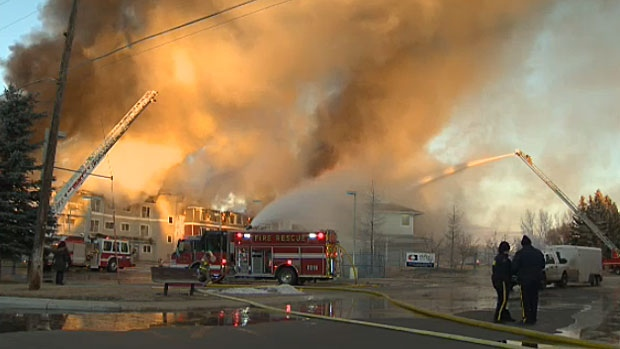 Smoke billows high into the air as fire tears through a seniors complex in High River on December 15, 2015.