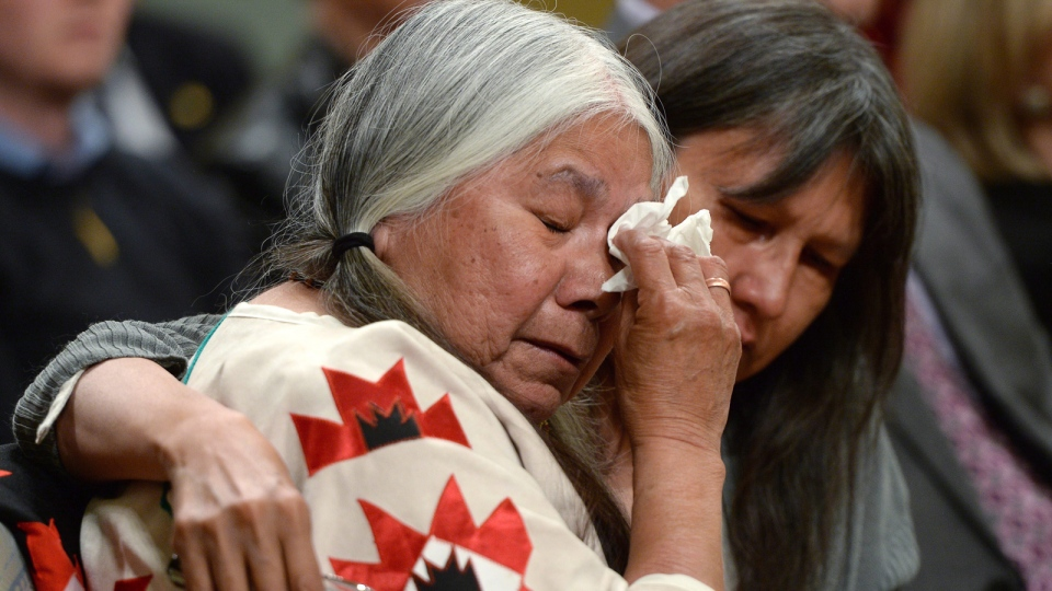 Residential school survivor Lorna Standingready is comforted by a fellow survivor in the audience during the closing ceremony of the Indian Residential Schools Truth and Reconciliation Commission, at Rideau Hall in Ottawa on Wednesday, June 3, 2015.(Sean Kilpatrick /  THE CANADIAN PRESS)