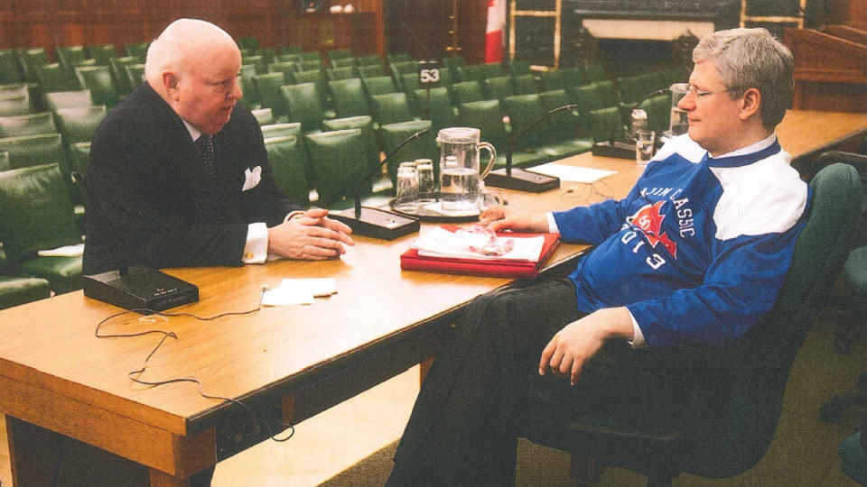 Mike Duffy and Stephen Harper in a photo submitted into evidence on Dec. 15, 2015.
