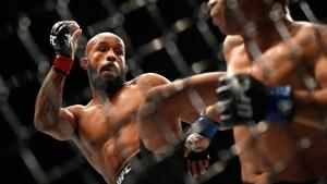 Demetrious Johnson kicks John Dodson at UFC 191,on Sept. 5, 2015. (John Locher / AP)