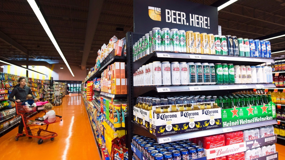 Beer is shown on newly stocked shelves as customers shop at a Loblaws grocery store in Toronto on Tuesday, Dec. 15, 2015. (Nathan Denette / THE CANADIAN PRESS)