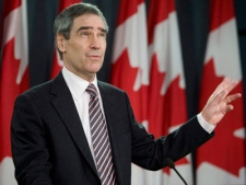 Liberal Leader Michael Ignatieff gestures as he speaks with the media during a news conference in Ottawa, Wednesday Dec. 10, 2008. (THE CANADIAN PRESS / Adrian Wyld)