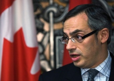 Minister of Industry Tony Clement speaks to media at a press conference in Toronto on Friday, December, 12, 2008. (THE CANADIAN PRESS / Nathan Denette)