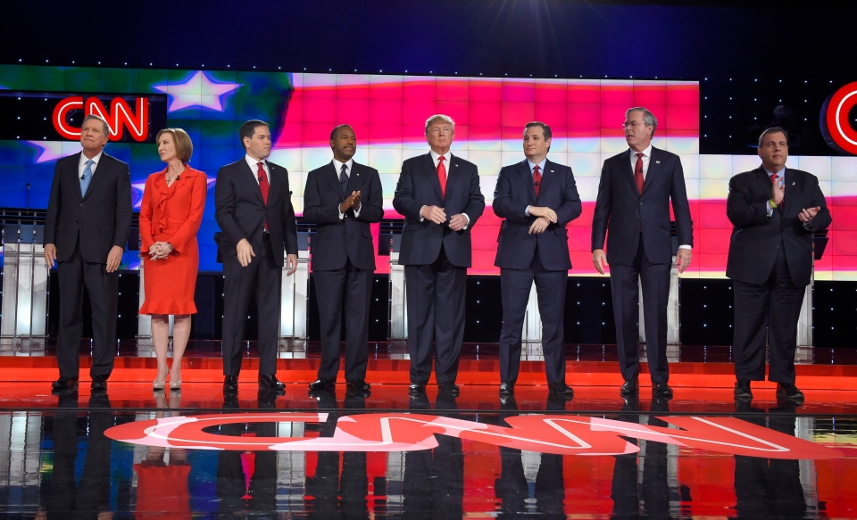 Republican presidential candidates, from left, John Kasich, Carly Fiorina, Marco Rubio, Ben Carson, Donald Trump, Ted Cruz, Jeb Bush, Chris Christie, and Rand Paul take the stage during the CNN Republican presidential debate at the Venetian Hotel & Casino on Tuesday, Dec. 15, 2015, in Las Vegas. (AP / Mark J. Terrill)