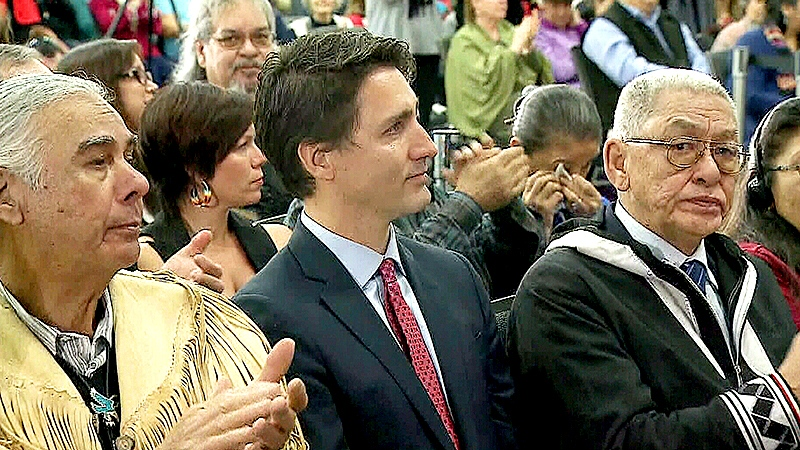 A teary Prime Minister Justin Trudeau listens as the Truth and Reconciliation Commission's final report is delivered.