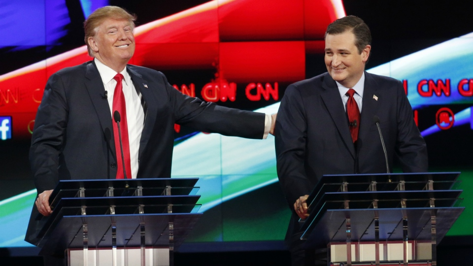 Donald Trump, left, jokes with Ted Cruz during the CNN Republican presidential debate at the Venetian Hotel & Casino in Las Vegas on Tuesday, Dec. 15, 2015. (AP / John Locher)