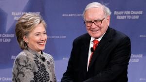 In this Dec. 11, 2007, file photo, billionaire investor Warren Buffett helps Democratic presidential candidate, then-Sen. Hillary Clinton, D-N.Y., raise campaign funds in San Francisco. (Paul Sakuma / AP Photo, File)