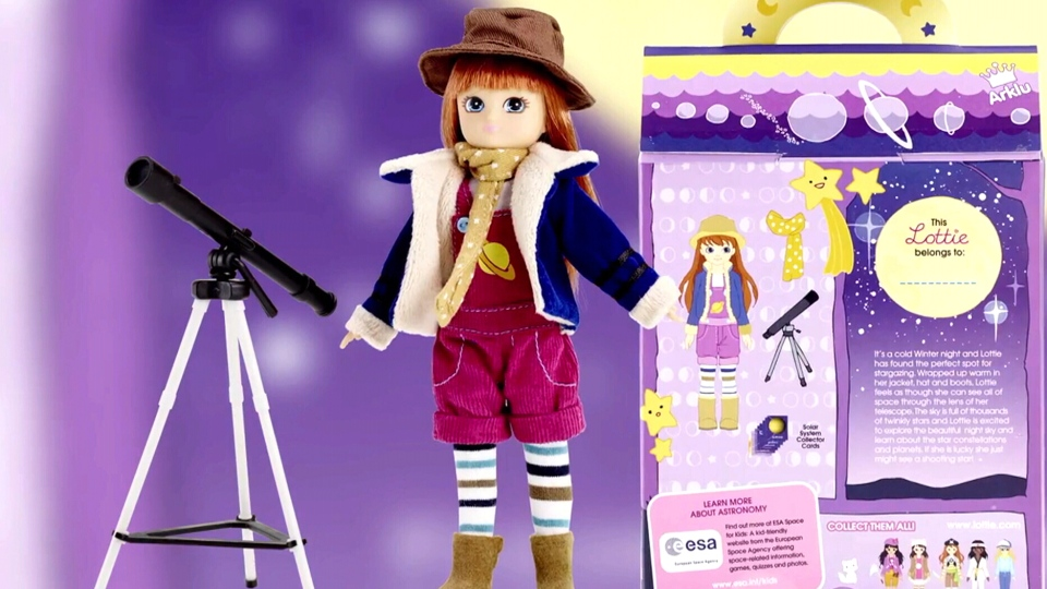 The 'Stargazer' Lottie doll comes with little brown boots, pink dungarees and a poster of notable women in astronomy.