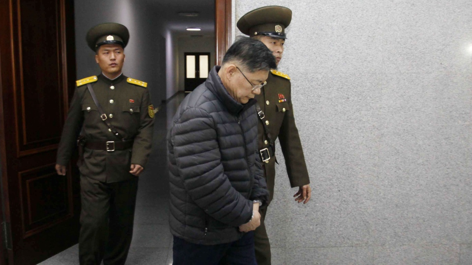 Hyeon Soo Lim, center, who pastors the Light Korean Presbyterian Church in Toronto, is escorted to his sentencing in Pyongyang, North Korea, Wednesday, Dec. 16, 2015.  (AP/ Jon Chol Jin)