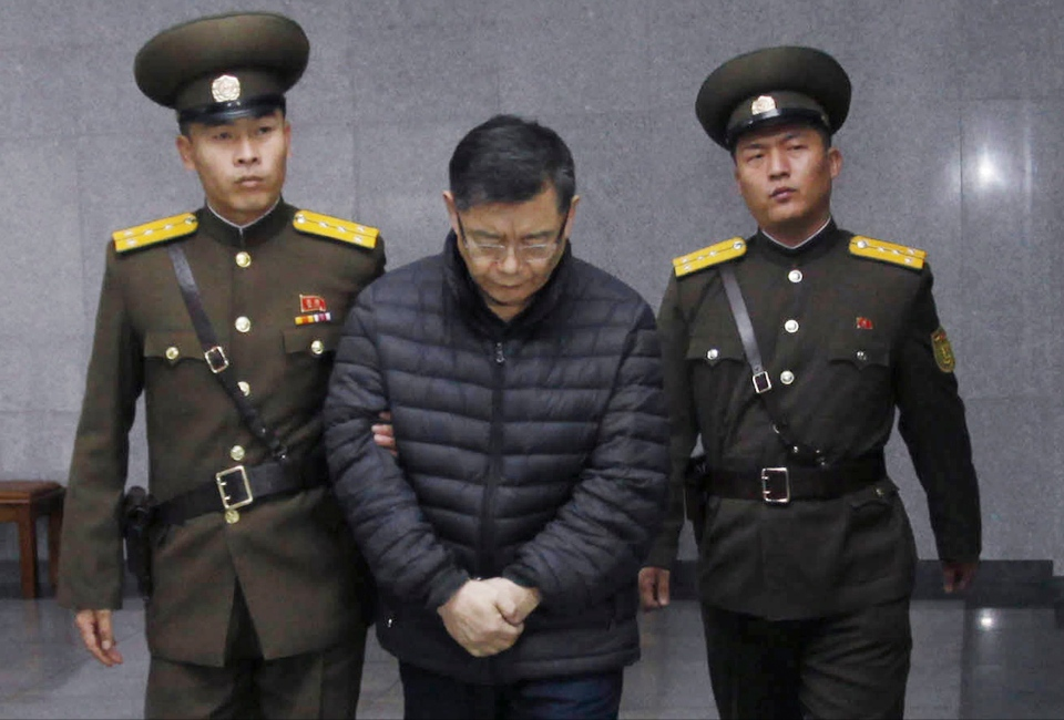Hyeon Soo Lim, centre, who pastors the Light Korean Presbyterian Church in Toronto, is escorted to his sentencing in Pyongyang, North Korea, Wednesday, Dec. 16, 2015. (AP / Jon Chol Jin)