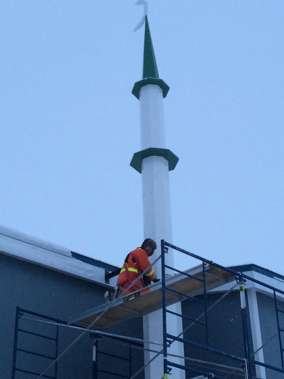 A construction worker is seen on scaffolding around Iqaluit's only mosque. The project cost an estimated $750,000.