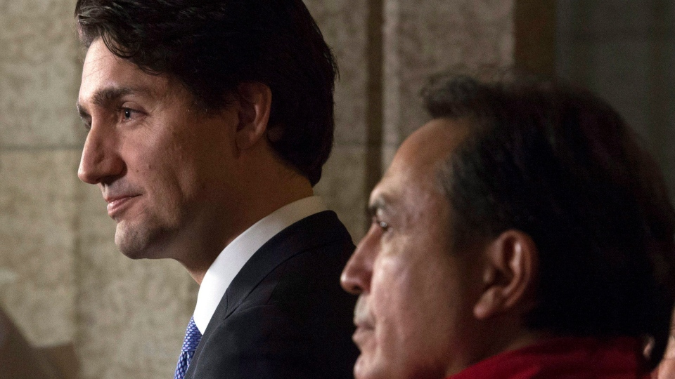 Prime Minister Justin Trudeau and Assembly of First Nations National Chief Perry Bellegarde listen to a question from the media following a on Parliament Hill in Ottawa Wednesday, December 16, 2015. (THE CANADIAN PRESS/Adrian Wyld)