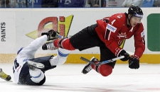 Eric Brewer of Canada, right, and Toni Soderholm of Finland collide during their World Ice Hockey championship final match in Moscow, Sunday, May 13, 2007. (AP / Dmitry Lovetsky)