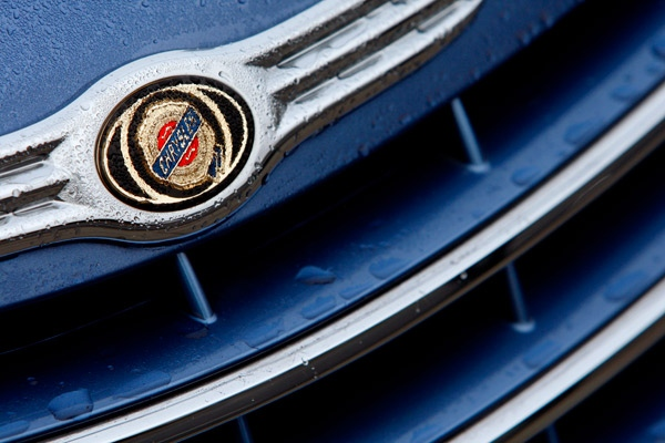 The badge on a Chrysler car covered with rain drops is seen at a showroom in London, Friday, Dec. 12, 2008. (AP / Kirsty Wigglesworth)
