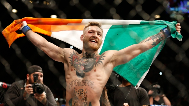 1bddbf9e27f440 Conor McGregor reacts after defeating Jose Aldo during a featherweight  championship mixed martial arts bout at UFC 194, Saturday, Dec.