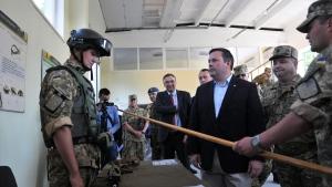 Ukrainian Defence Minister Stepan Poltorak, 2nd right, and Canadian Defence Minister Jason Kenney, centre, in the Lviv region of Ukraine, on June 27, 2015. (Pavlo Palamarchuk / AP)