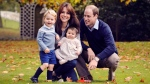 This photo released by Kensington Palace on Friday Dec. 18, 2015 shows The Duke and Duchess of Cambridge with their two children, Prince George and Princess Charlotte, in a photograph taken late October 2015 at Kensington Palace in London. (Chris Jelf)