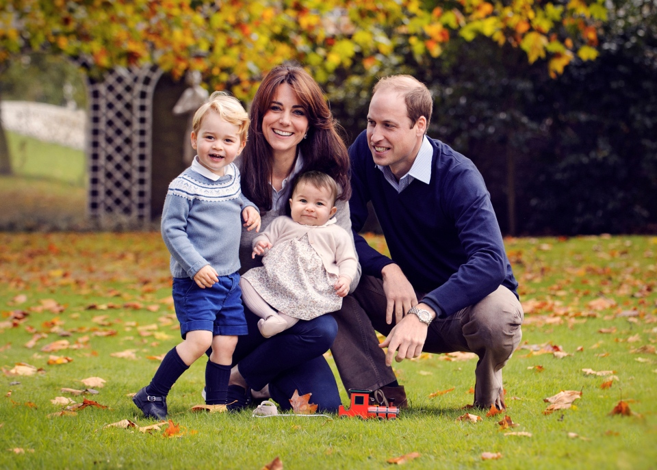This photo released by Kensington Palace on Friday Dec. 18, 2015 shows The Duke and Duchess of Cambridge with their two children, Prince George and Princess Charlotte, in a photograph taken late October 2015 at Kensington Palace in London. (Chris Jelf via AP)