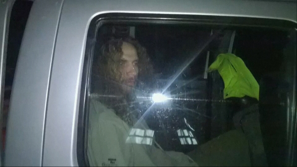 Joshua Andrew Freeman Stevens is seen in a police truck in Peru after allegedly stabbing a British tourist to death after drinking a hallucinogenic brew.