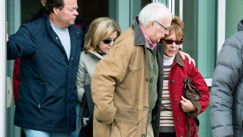Constance Oland, right, mother of Dennis Oland, is followed by his wife Lisa Oland, from the Law Courts where he was found guilty of second degree murder in the death of his father, Richard Oland, in Saint John, N.B. on Saturday, Dec. 19, 2015. (Andrew Vaughan  / The Canadian Press)