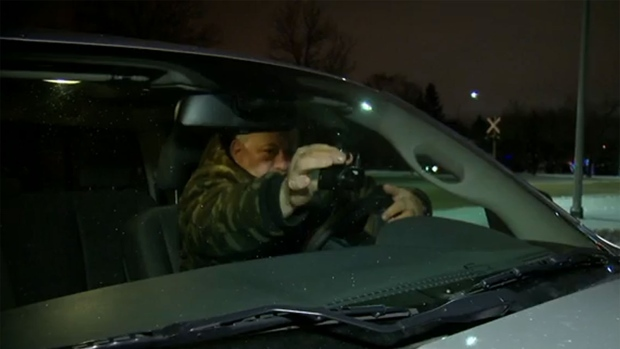 Les Yasinsky sets a camera on his dashboard before heading out to watch for drunk divers.