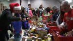 Volunteers sort through donations for the Christmas Cheer campaign on Tuesday, Dec. 15, 2015 in Barrie, Ont. (Roger Klein/ CTV Barrie)