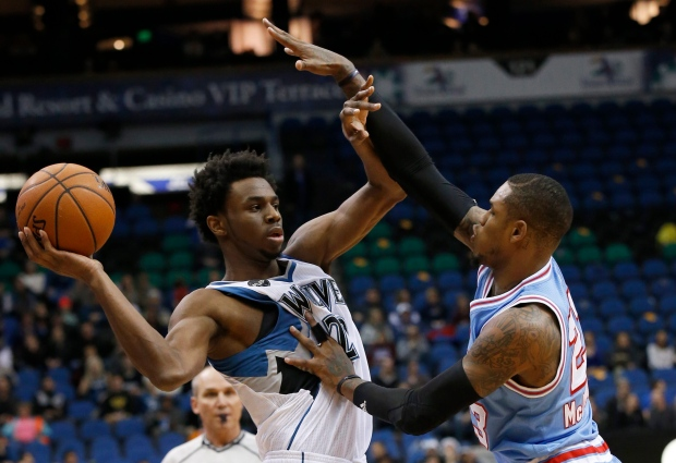 Minnesota Timberwolves guard Andrew Wiggins, left, looks to pass to a teammate under pressure from Sacramento Kings guard Ben McLemore, right, during the first half of an NBA basketball game in Minneapolis on Dec. 18, 2015. (Ann Heisenfelt / AP Photo)
