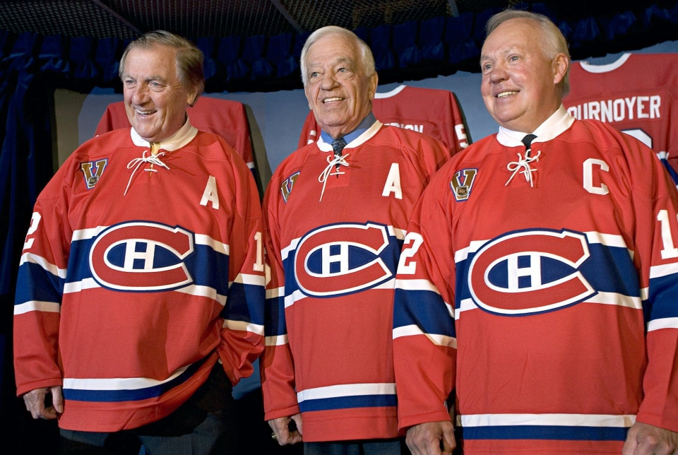 """Former Montreal Canadiens Dickie Moore, Bernard """"Boum Boum"""" Geoffrion and Yvan Cournoyer, left to right, pose for a photograph during a new conference announcing they will have their jerseys retired this season on Oct. 15, 2005 in Montreal. (Paul Chiasson / The Canadian Press)"""