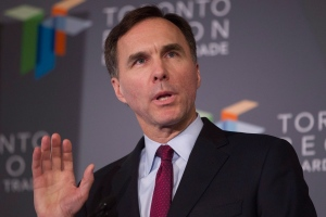 Federal Finance Minister Bill Morneau speaks to media after delivering remarks at a Toronto Region Board of Trade Luncheon, in Toronto, on Monday, Dec. 14, 2015. (Chris Young/THE CANADIAN PRESS)